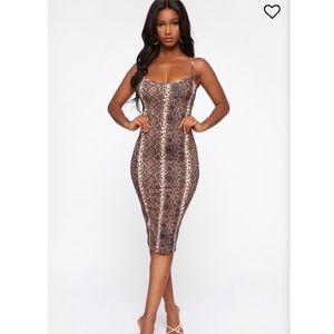 Skin tight snake print dress